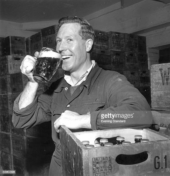 Sidney Heffer a machine operator in the bottling department of Watney's Brewery enjoying a pint of beer