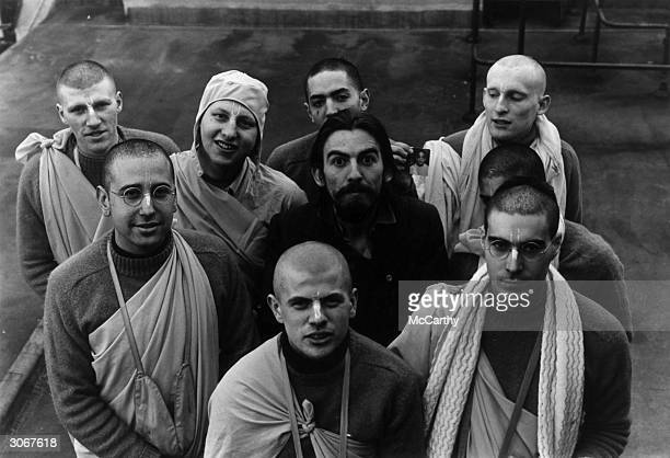 British rock star George Harrison with friends from a Hare Krishna Temple who have just made a record