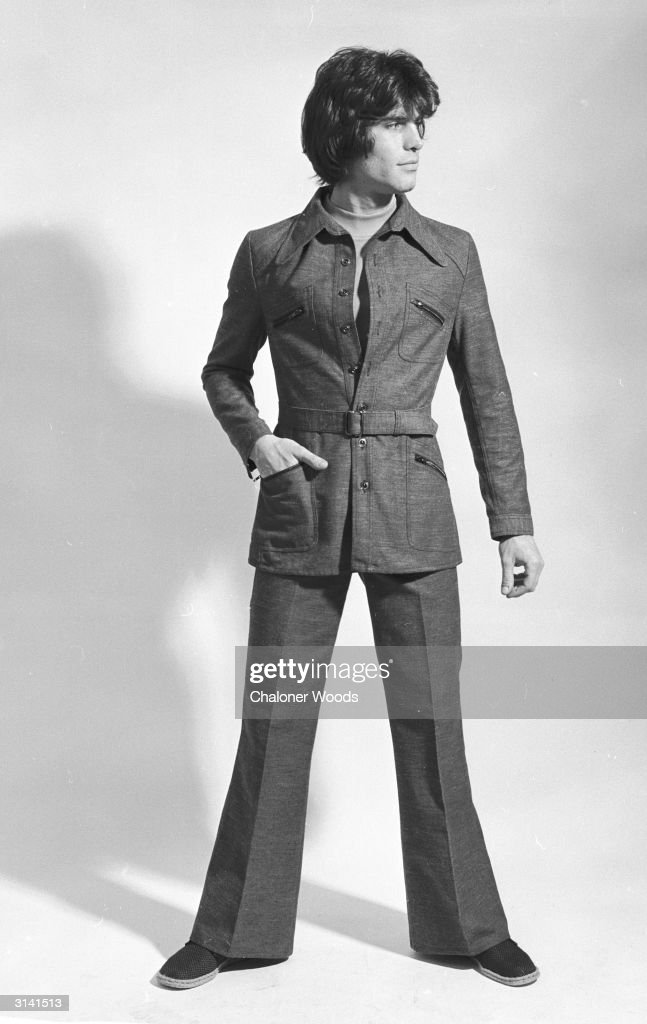 A man's trouser suit with flared trousers, belted jacket and patch pockets.