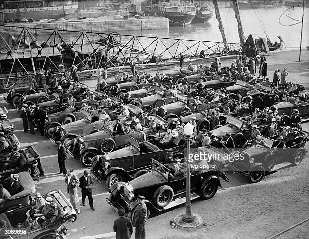 The passengers of the Red Star cruise ship Lapland form an orderly queue at the quayside in their motor cars