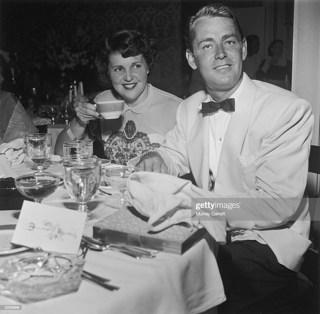 EXCLUSIVE American actor Alan Ladd sits with his wife Sue Carol at Betty Hutton's party celebrating the wedding of Hollywood entertainment columnist...