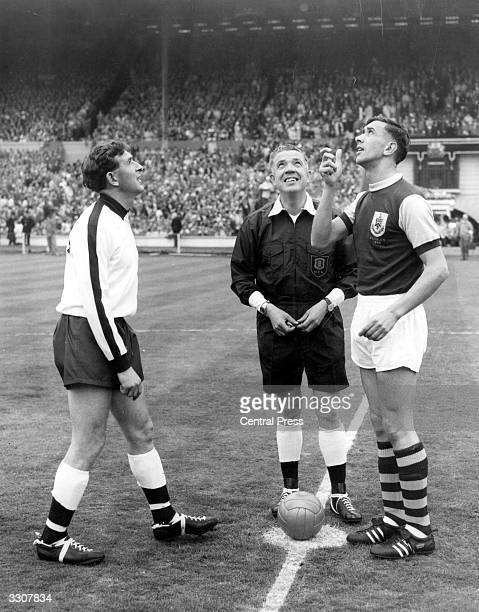 Burnley captain Jimmy Adamson tosses a coin for the start of the 1962 FA Cup Final watched by Tottenham Hotspur skipper Danny Blanchflower and the...