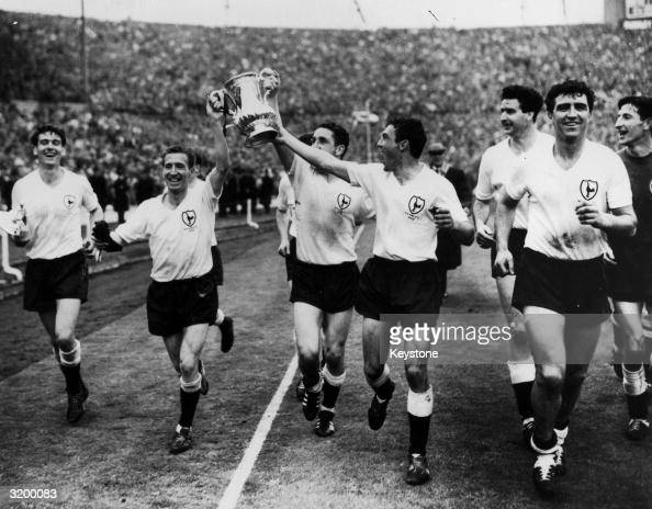 Tottenham Hotspur footballers celebrating with the FA Cup at Wembley after beating Burnley 3 1 to win the trophy for the second year running Left to...