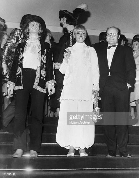 Brian Jones of the rock group the Rolling Stones and his girlfriend actress Anita Pallenberg arriving at a screening of 'Mord Und Totschlag' during...