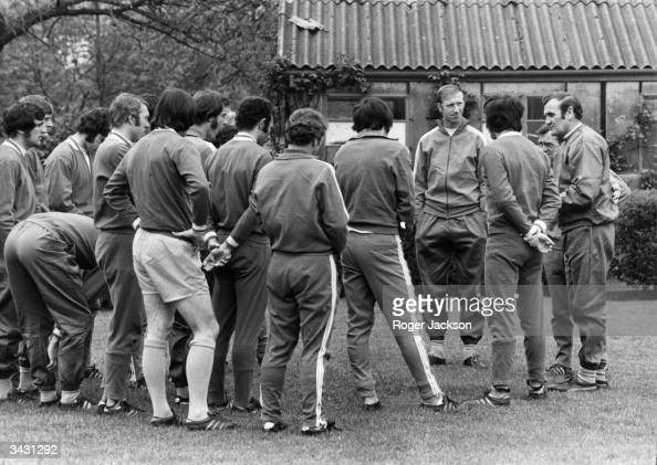 Leeds United manager Don Revie talking to his squad including Jack Charlton during a training sesson at Sunny Hill Park