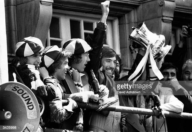 Members of the FA Cup winning West Ham side celebrating on the balcony of Newham Town Hall Kevin Lock Billy Jennings Tommy Taylor and Billy Bonds