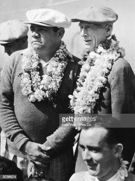 American baseball player Babe Ruth and baseball manager Connie Mack of the Philadelphia Athletics wear leis which they received upon their arrival in...