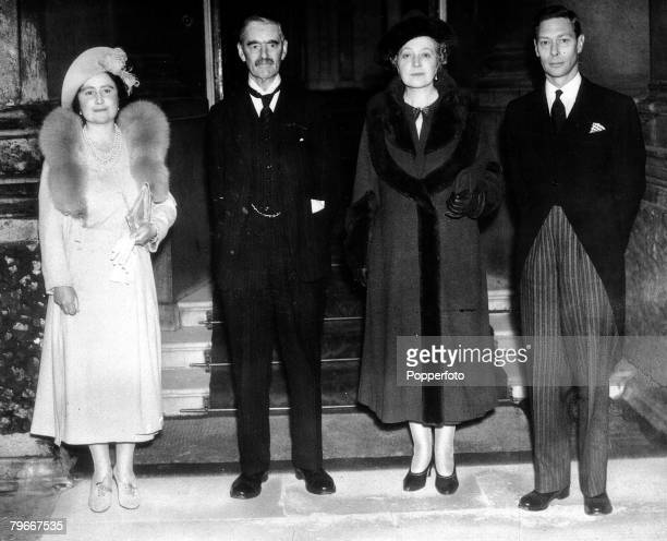 5th November 1938 British Prime Minister Neville Chamberlain and his wife can be seen on the balcony at the Palace with King George VI and Queen...