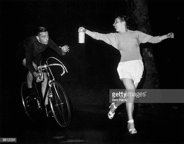 During his London to Brighton cycling speed record attempt Ken Joy receives his 'bidon' an aluminium can containing milk and sugar Original...