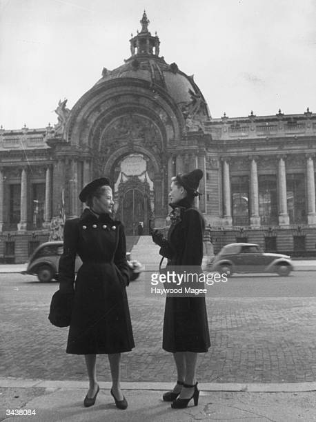 Two models pose in the street in coats by Piguet Paris One model's shoes have peeptoes anklestraps and slingbacks Original Publication Picture Post...