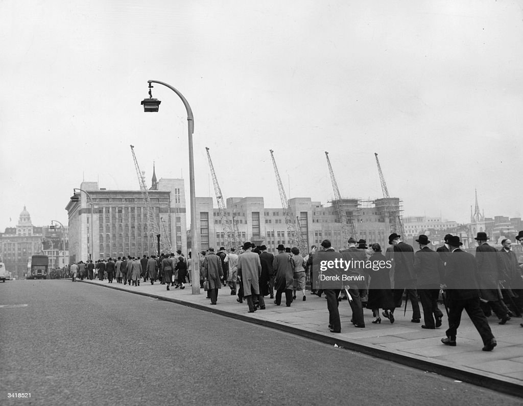City workers crossing London Bridge on their way to work on the third day of a bus strike
