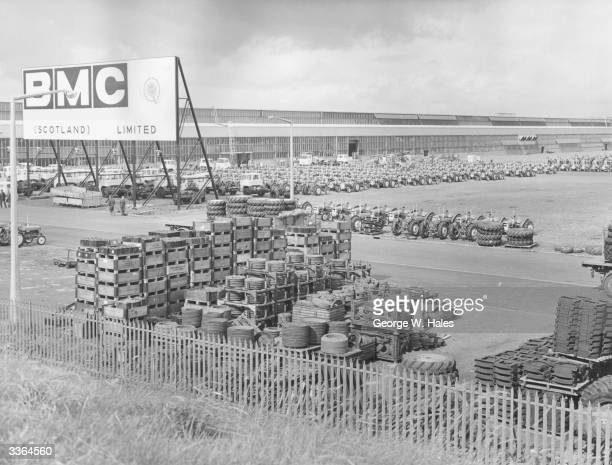 A pile of vehicle parts and tractors and commercial vehicles lined up at BMC's factory at Bathgate This factory provided many jobs for the area and...