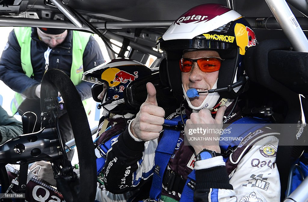 5th place Belgium's Thierry Neuville reacts after crossing the finish line of the 22nd and the last stage of Rally Sweden, FIA World Rally Championship second round in Karlstad, Sweden on February 10, 2013.