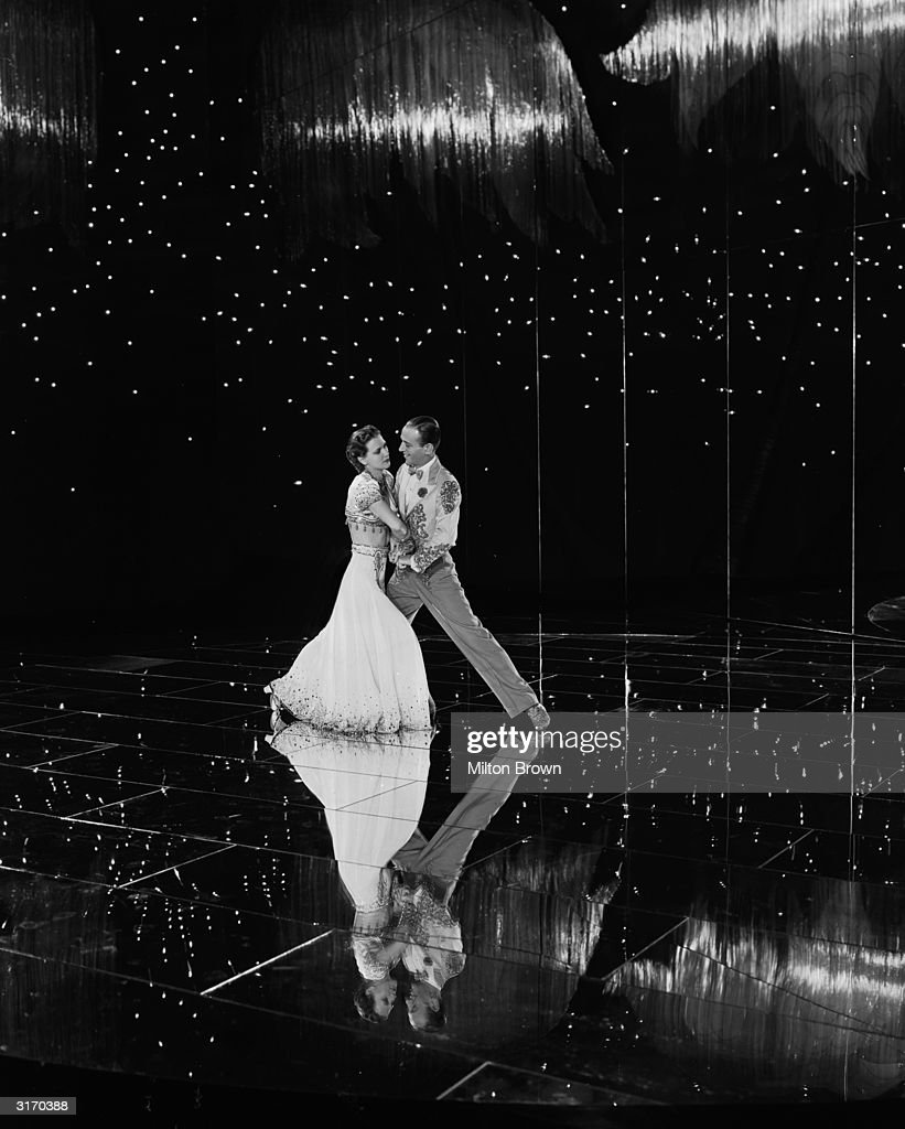 Fred Astaire (1899 - 1987) and Eleanor Powell (1912 - 1982) dancing across a glittering stage in a scene from the musical 'Broadway Melody of 1940', directed by Norman Taurog.