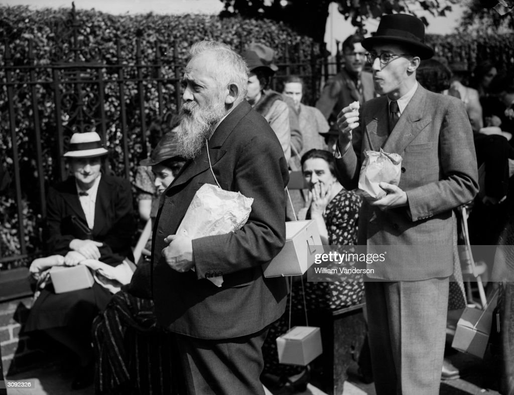 Immigrants queuing up with their lunch at a church in Golders Green London for a registration ceremony