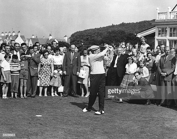 American President Dwight D Eisenhower drives down the fairway surrounded by onlookers at Turnberry golf course during a weekend stay at Culzean...