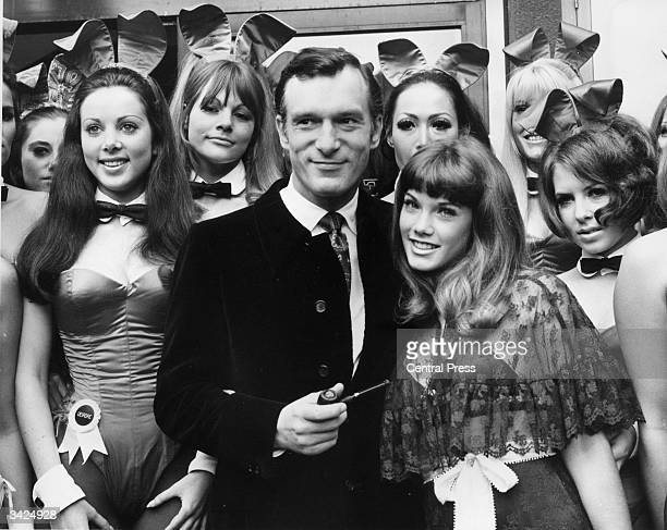 Hugh Hefner head of the Playboy Clubs on a visit to his London club in Park Lane London With him is his 19 year old girl friend Barbara Benton and a...