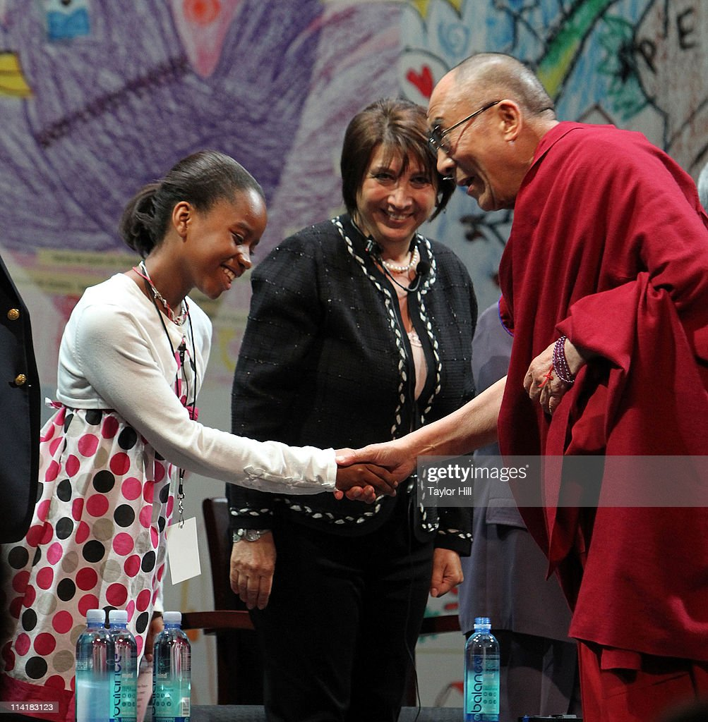 A 5th-grader greets the Dalai Lama Tenzin Gyatso at the Newark Peace Education Summit at New Jersey Performing Arts Center on May 14, 2011 in Newark, New Jersey.