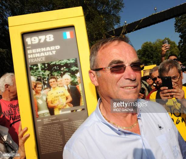 5time Tour de France winner Bernard Hinault poses next to his totem as part of the 'Tour of Giants' a memorial of 101 totems dedicated to the 101...