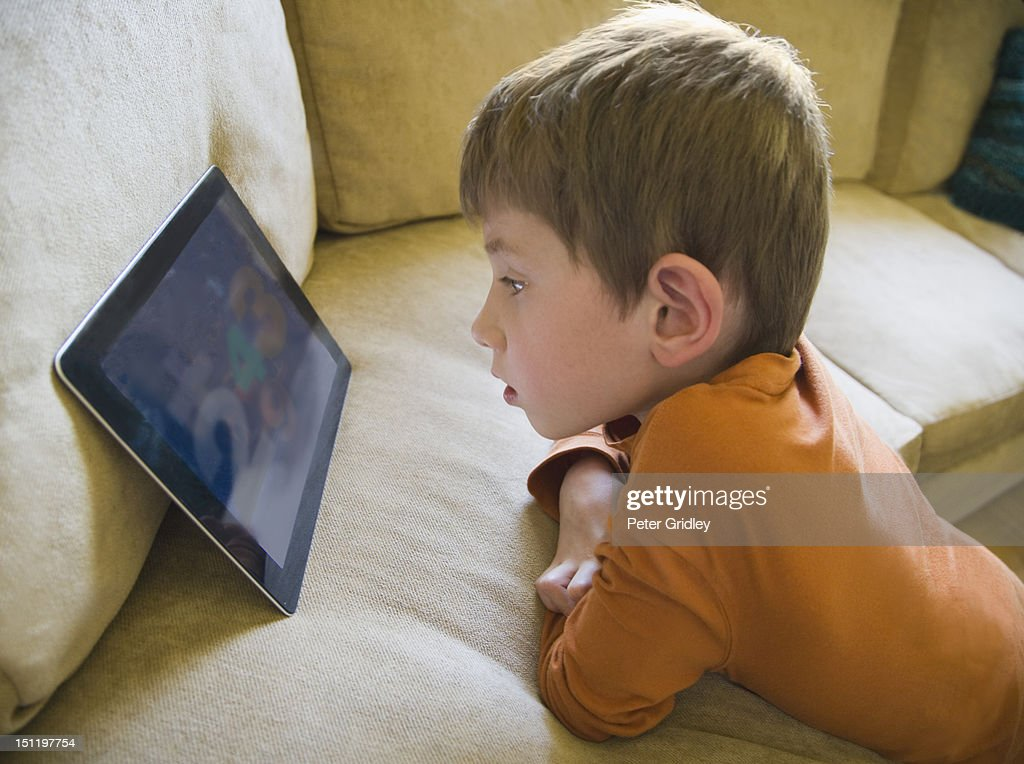 5-year-old boy with a digital tablet : Stock Photo