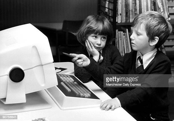 �5yearolds Ian Ruffles and Suzanne Spencer are somewhat puzzled by the new computer �Cecil� the first in a British infants� school�