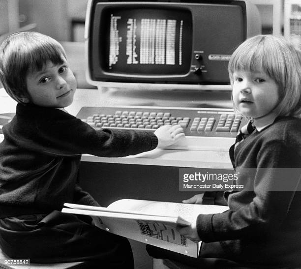 �5yearolds Mark Goulden and Nicola Millar look forward to the future with �Cecil� the first computer in a British infants� school�