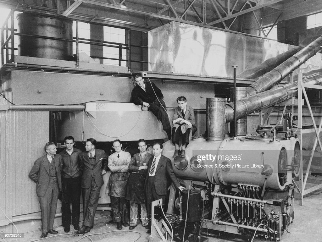 60-inch cyclotron, c 1930s. This shows the cyclotron at the Lawrence Radiation Laboratory, Berkeley, sonn after completion in 1939. The key figures in its development and use are shown, standing, left to right: Dr D Cooksey, Dr D Corson, Dr EO Lawrence (1901-58), the inventor of the cyclotron, Dr R Thornton, Dr J Backus, WS Sainsbury, Dr LW Alvarez (1911-88) and Dr EM McMillan (1907- ). Copyright American Institute of Physics (AIP).