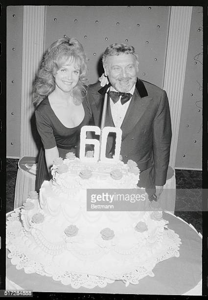 60th Birthday Manhattan New York New York Entertainersinger Frankie Laine gets an assist from pretty actress Maura Hayden as he attempts to blow out...