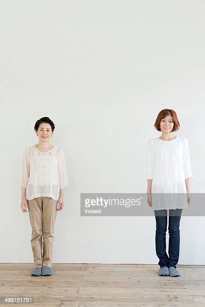 60th generation woman standing with her daughter
