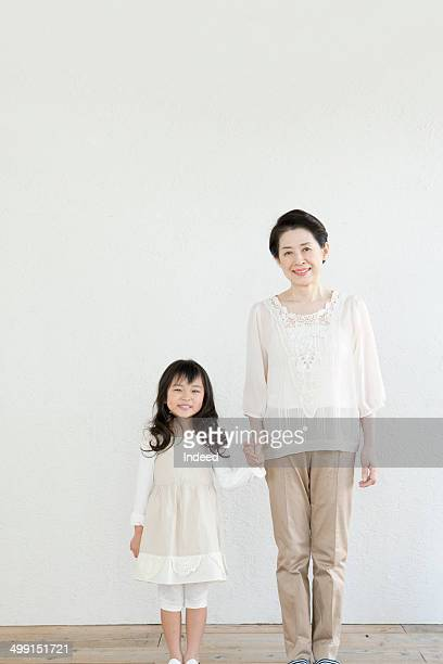 60th generation woman standing with her grand daughter