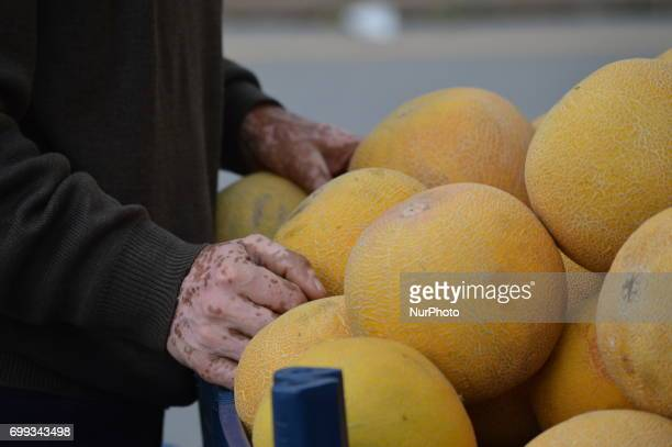 60yearold peddler's hands are pictured in front of his truck in Ankara Turkey on June 21 2017 60 and 77yearold two peddlers sell melons and...
