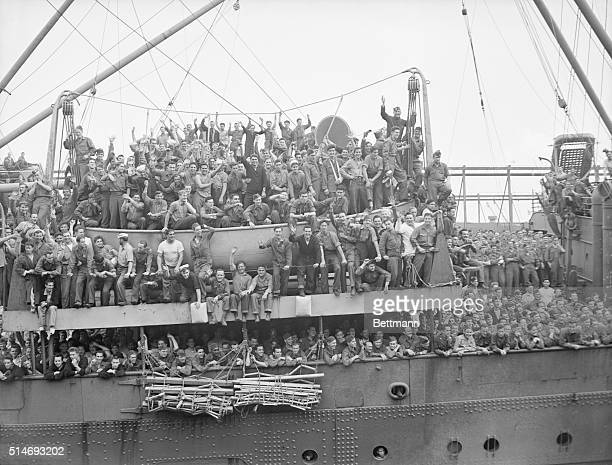 Waving from the deck of the USS Washington as she arrived in New York Harbor today June 11th from Europe are some of the 1593 naval personnel most of...