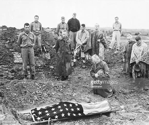 6/14/1945Okinawa Lest we forgetthis photo shows how one father spent Father's Day Marine Colonel Francis I Fenton of San Diego Calif kneels beside...