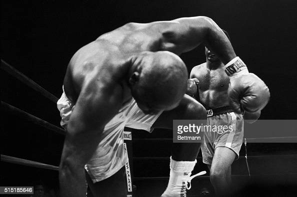 6/15/1976Uniondale New YorkUnder a barrage by George Foreman Joe Frazier heads for the canvas in the fifth round