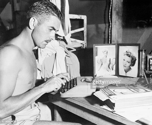 Like all men away from home Marine 1st Lt Tyrone Power former film star spends his free time on Saipan Island typing a Vmail letter to his wife...