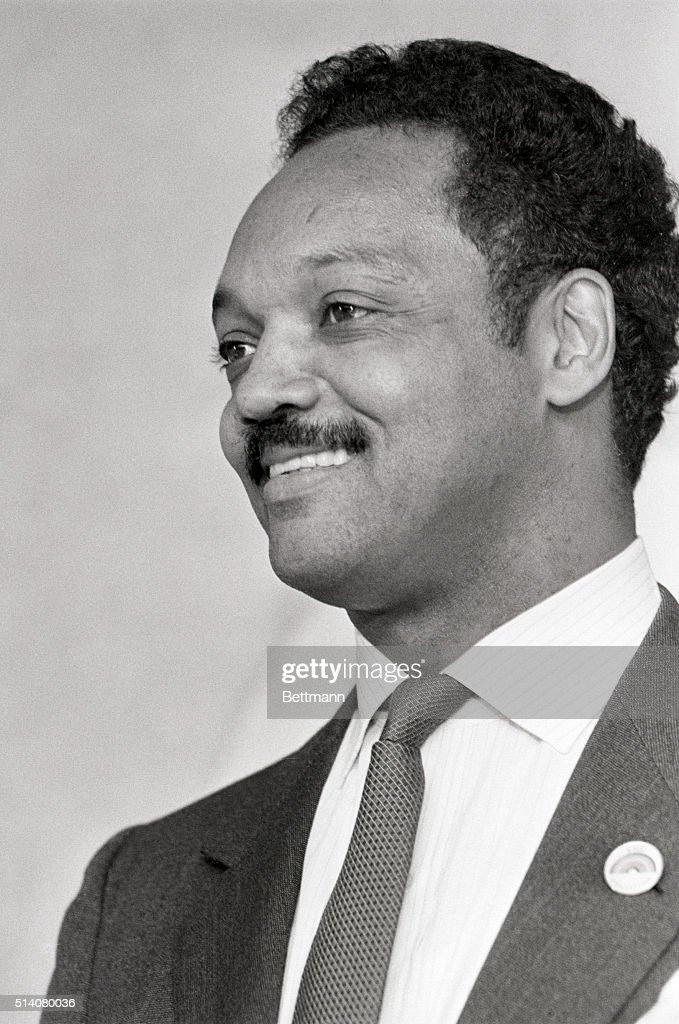A smiling Jesse jackson fields questions during a 6/16 news conference here as Jackson introduced members of his Rainbow Coalition, from Maine, New hampshire, and vermont. Rev. Jackson is presently considered to be the front-runner in the Democratic race for the Presidential nomination. esw/Gene Willman