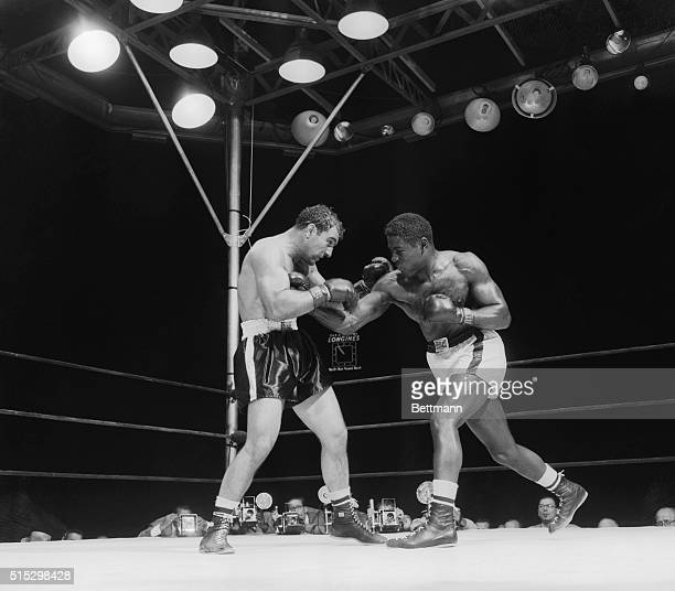 6/17/1954New York New York Ezzard Charles delivers a hard right to Rocky Marciano's chest during their 15round Heavyweight Championship match at...