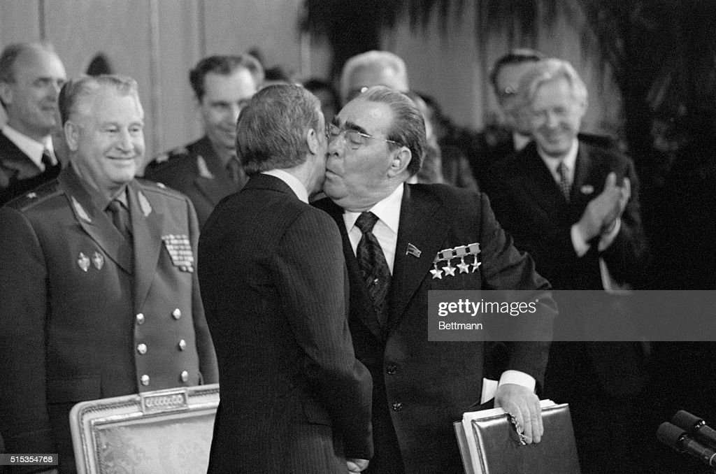 Vienna, Austria- Soviet President Brezhnev, holding the signed copy of the SALT II Treaty, plants a kiss on the cheek of President Jimmy Carter. The treaty was signed at the Redoutensaal after two days of meetings.