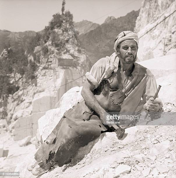 6/18/1964Rome Italy Dressed in a leather apron Charlton Heston prepares to chisel a chunk of mount Altissimo in the famous Carrara Marble Quarry...