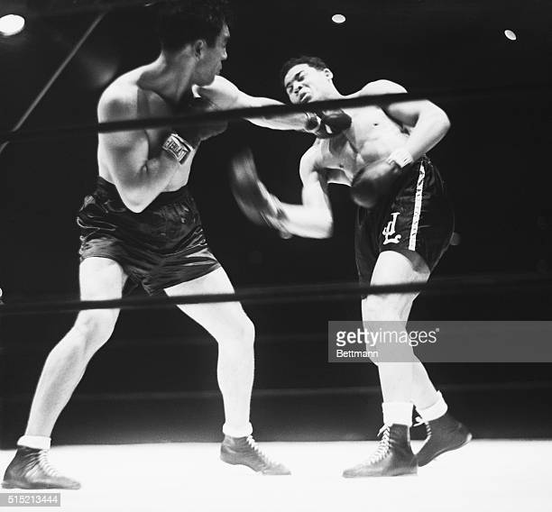 6/19/1936Max Schmeling lands a left to the face of Joe Louis in their boxing match