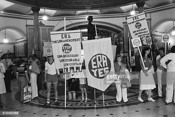 6/19/1980Springfield IL Anti and pro ERA forces stand side by side in the main hall of the Illinois State Capital to show their support for and...