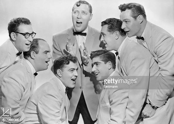 6/1956Picture shows the rock and roll singing group Bill Haley and the Comets posing together and singing with Bill Haley in the middle and three men...