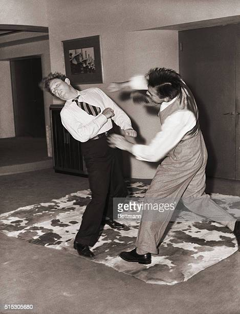 6/21/1940HolywoodCA A dustup that looks like the McCoy is this Baby Blitzkrieg staged between Spencer Tracy and Clarke Gable in the filming of 'Boom...