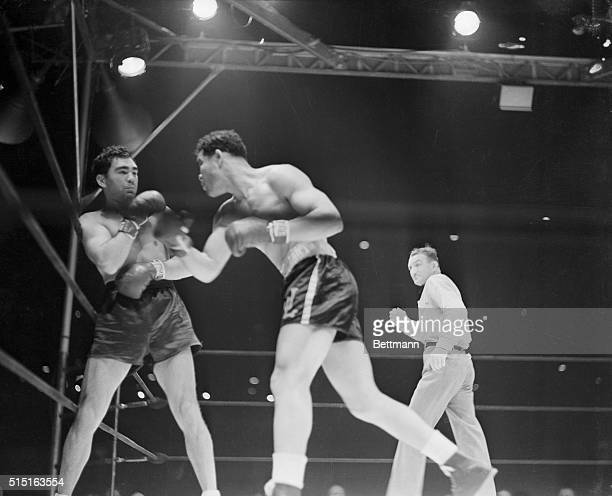 6/22/1938New York New York Against the ropes Max Schmeling vainly tries to protect himself as Joe Louis bores in with more stunning blows Defeat came...