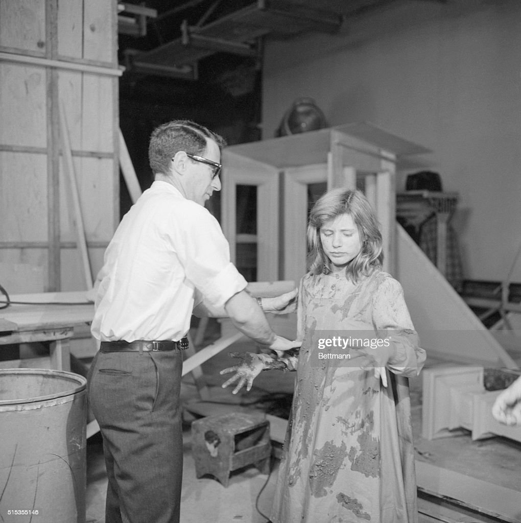 6/23/1961New York NY Director Arthur Penn helps muddy Patty Duke's pinafore for a scene during filming of 'The Miracle Worker' a screen adaptation of...
