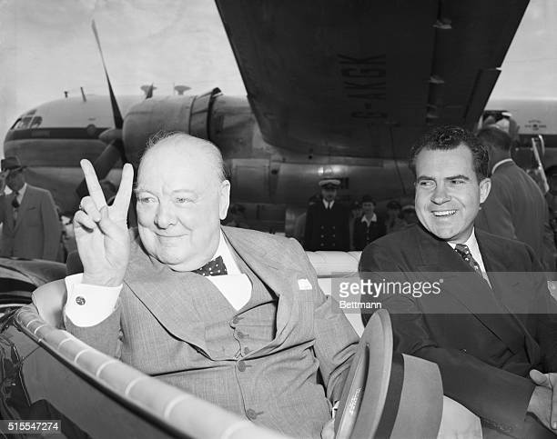6/25/1954Washington DC British Prime Minister Sir Winston Chuchill gives his famous victory sign from the backseat of a car at a Washington airport...