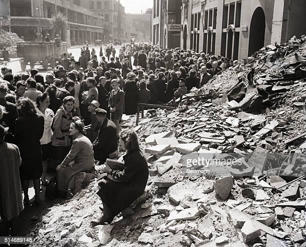 6/26/1948Berlin Germany A long line of Berliners queue in front of bank in Russian sector waiting to exchange old Reichmarks for new Russian stamped...