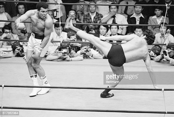 6/26/1976Tokyo Japan Muhammad Ali dances as Japanese wrestler Antonio Inoki tries a leg kick during the 4th round of their wrestlingboxing exhibition...