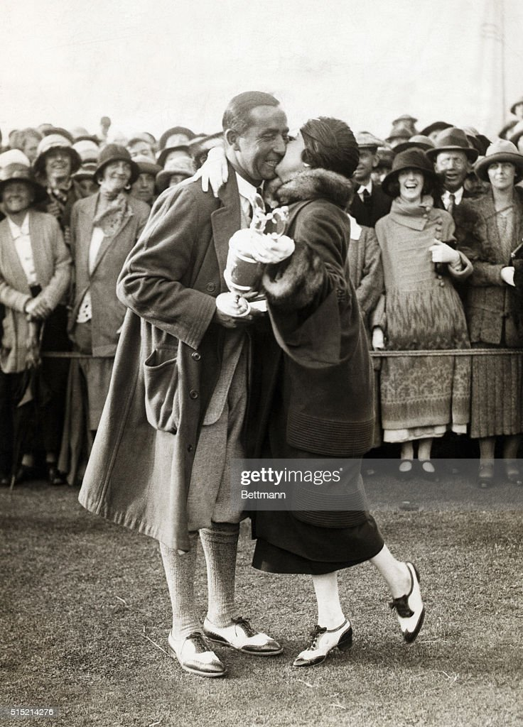 Walter Hagen, the American professional, won the British Open Golf Championship at Hoylake by only one stroke. After making a two yard putt at the 18th hole, he threw his club up in the air and was immediately embraced by his wife in celebration of the most dramatic victory.