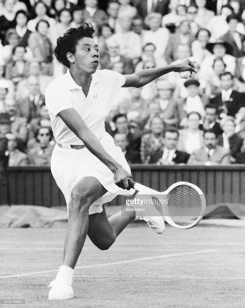 London, England- Althea Gibson, in action at Wimbledon, is shown is some fancy hand and foot action during play against Mrs. Z. Kormoczy of Hungary in the second day round of Tennis Championships at Wimbledon. Miss Gibson won in two straight sets in this first round of the ladies singles.